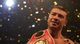 IBF Super Middleweight champion Bute of Romania celebrates after defending his title in a boxing match against challenger Mendy of France in Bucharest