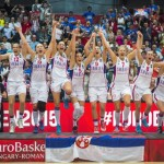Players of Serbia celebrate on the podium after they defeated France and won the gold medal in Women's Basketball European Championship final match in Budapest, Hungary, Sunday, June 28, 2015. (Tibor Illyes/MTI via AP)