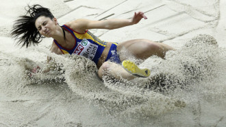 Romania's Florentina Marincu makes an attempt in the women's long jump final at the European Athletics Indoor Championships in Prague, Czech Republic, Saturday, March 7, 2015. (AP Photo/Petr David Josek)